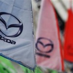 Logos of Mazda Motor Corp are seen at a dealership in Tokyo